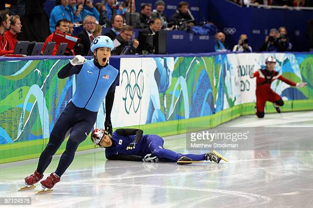 Apolo Anton Ohno of the United States reacts after crossing the line after FrancoisLouis Tremblay of Canada and Sung SiBak of South Korea crashed in...