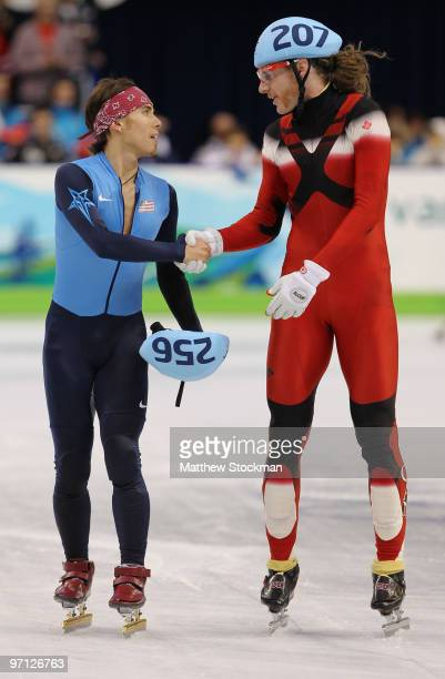 Apolo Anton Ohno of the United States shakes hands with Olivier Jean of Canada after Canada won the gold medal and the United States won bronze in...