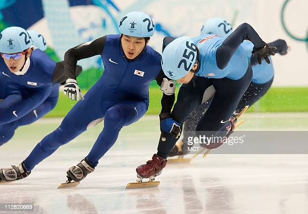 Apolo Anton Ohno of the United States stumbles after making contact with Sung SiBak of Korea on Ohno's way to winning silver in the 1500meter short...