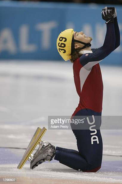 Apolo Anton Ohno of the USA celebrates winning the gold medal in the men's 1500m speed skating final during the Salt Lake City Winter Olympic Games...