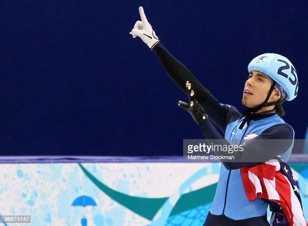 Apolo Anton Ohno of United States holds up six fingers representing his sixth medal after winning the silver medal in the Men's 1500 m Short Track...