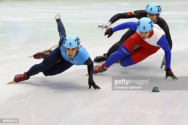 Apolo Anton Ohno of United States leads Jean Charles Mattei of France and Pieter Gysel of Belgium during a heat of the men's 1500 m men's short track...
