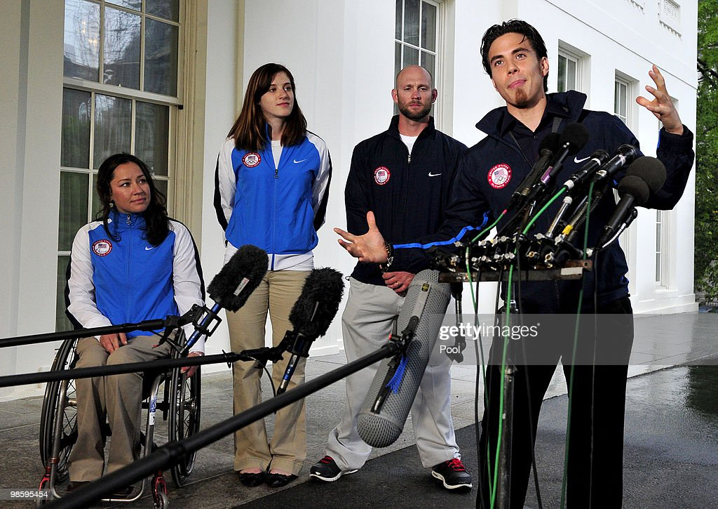 Apolo Anton Ohno, Olympic Short Track Speed Skater, makes remarks to reporters after meeting United States President Barack Obama and first lady Michele Obama at the White House on April 21, 2010 in Washington, DC. From left to right: Alana Nichols, Paralympic Sit Skiier; Katherine Reutter, Olympic Speed Skater; Heath Calhoun, Paralympic Sit Skiier; and Apolo Ono. President Obama and first lady Michelle Obama went from room to room of the Executive Mansion, greeting Olympic and Paralympic team members who recently competed in Vancouver games.
