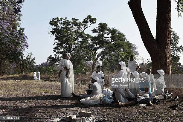 Apostolic Christians conduct a religious service in a piece of open land in the capital city of Harare Zimbabwe on October 6th 2015 The faith has...