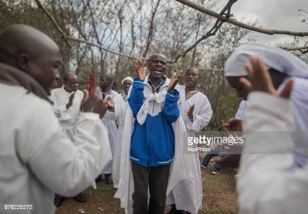 Apostolic Christians conduct a religious service in a piece of open land in the capital city of Harare Zimbabwe on November 19 2017 A day after huge...
