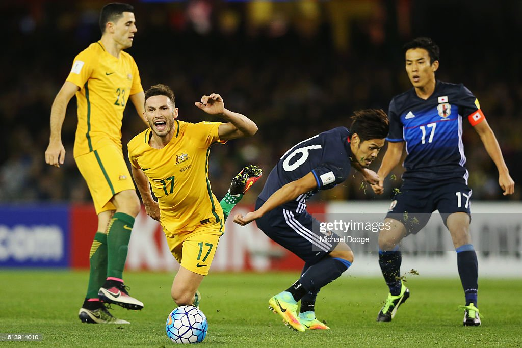 Apostolos Giannou of the Socceroos is tripped by Hotaru Yamaguchi of Japan during the 2018 FIFA World Cup Qualifier match between the Australian Socceroos and Japan at Etihad Stadium on October 11, 2016 in Melbourne, Australia.