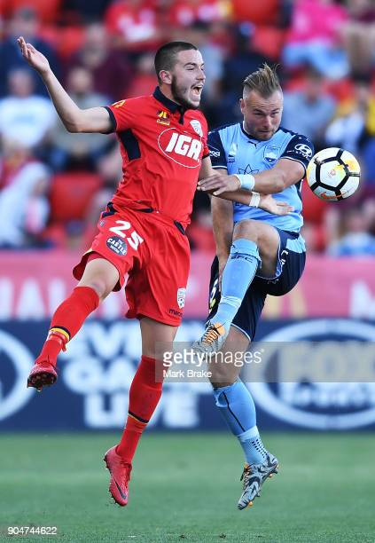 Apostolos Stamatelopoulos of Adelaide United competes with Jordy Buijs of Sydney FC during the round 16 ALeague match between Adelaide United and...