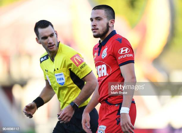 Apostolos Stamatelopoulos of Adelaide United gets warned by referee Jarred Gillett during the round 16 ALeague match between Adelaide United and...