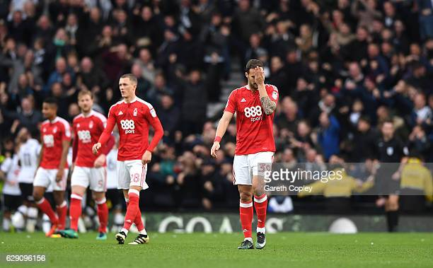 Apostolos Vellios of Nottingham Forest and team mates look dejected during the Sky Bet Championship match between Derby County and Nottingham Forest...