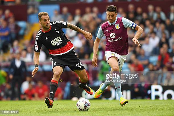 Apostolos Vellios of Notts Forest in action with Tommy Elphick of Villa during the Sky Bet Championship match between Aston Villa and Nottingham...