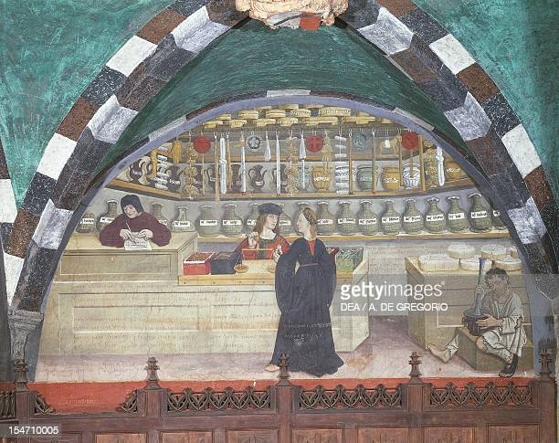 Apothecary shop 15thcentury fresco in a lunette above the porch of Issogne Castle Italy 15th16th centuries