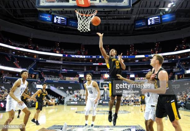 Appalachian State Mountaineers forward Isaac Johnson scores in the first half against Georgetown Hoyas guard James Akinjo on December 18 at the...