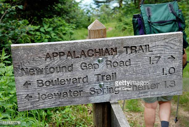 Appalachian Trail sign and backpacker