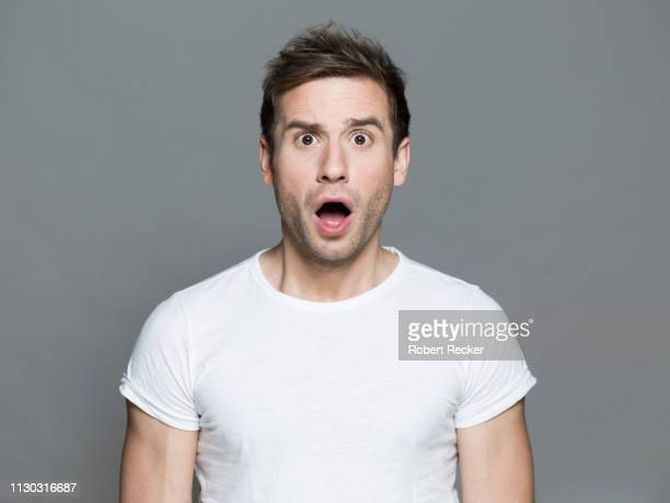 appalled young man - facial expression stock pictures, royalty-free photos & images