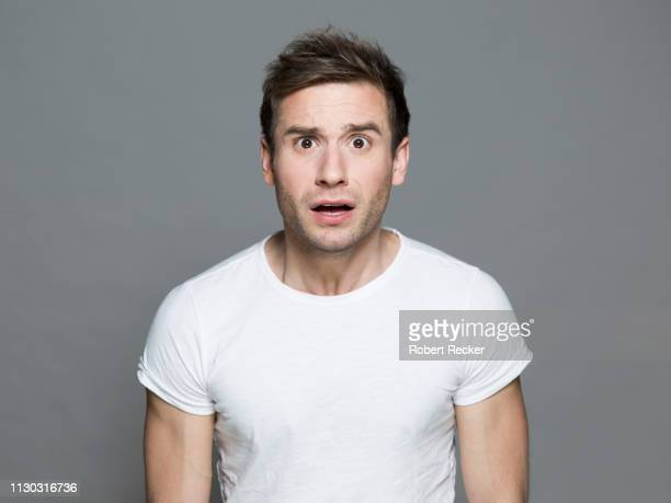 appalled young man - fear stock pictures, royalty-free photos & images