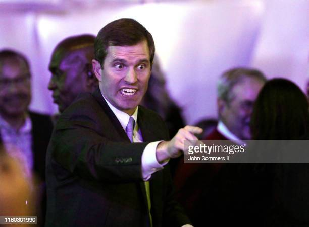 Apparent Govelect Andy Beshear acknowledges supporters after voting results showed the Democrat holding a slim lead over Republican Gov Matt Bevin at...