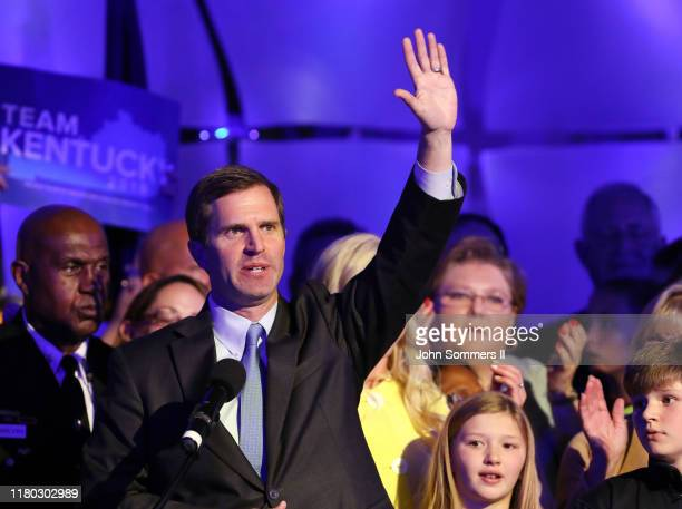 Apparent Gov.-elect Andy Beshear celebrates with supporters after voting results showed the Democrat holding a slim lead over Republican Gov. Matt...