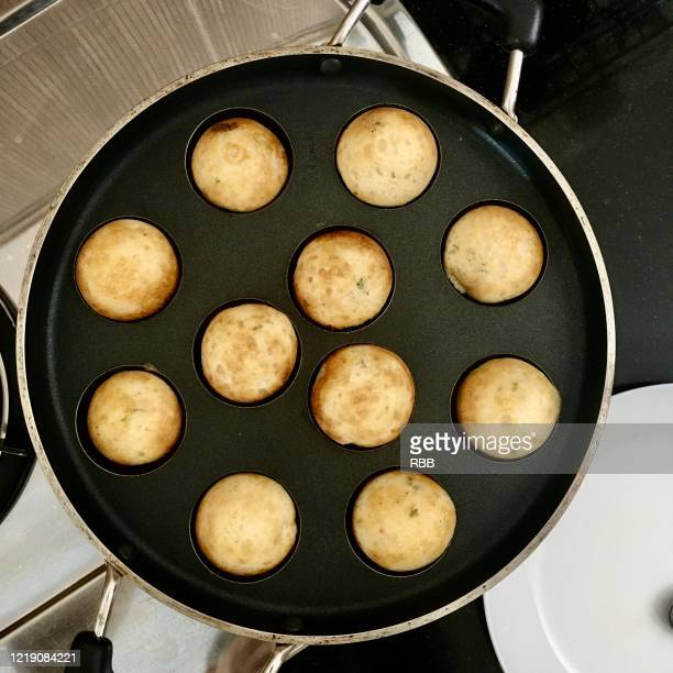 appe on hot pan - soapstone stock pictures, royalty-free photos & images