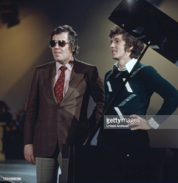 Appearance of the German actor, presenter, singer, composer and book author Michael Schanze and actor Wim Thoelke, Germany at the end of the 1970s.