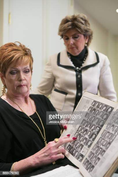 Appearing with attorney Gloria Allred Beverly Young Nelson points to a photo of Roy Moore's wife Kayla in a 1977 yearbook signed by Alabama Senate...