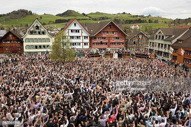 Appenzell Innerrhoden citizens cast their votes by raising their hand on April 29 2012 in Appenzell Switzerland The Landsgemeinde now only practised...