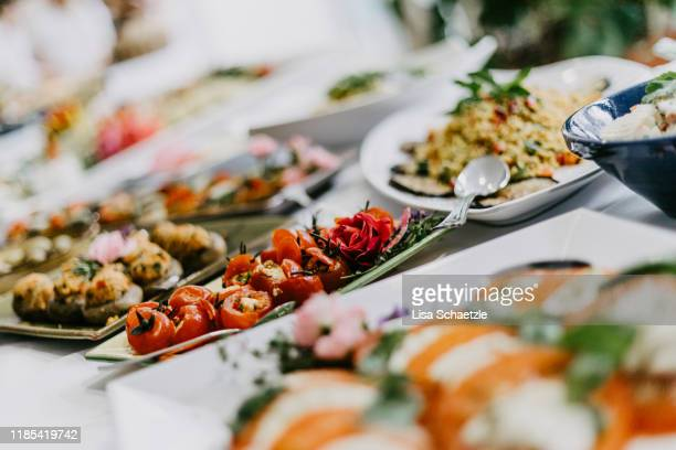 appetizer dishes on the buffet at a party - food and drink industry stock pictures, royalty-free photos & images