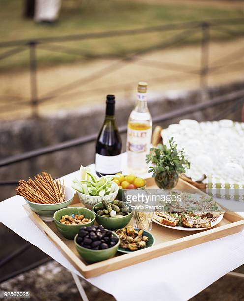 Appetizers and beverages on outdoor table