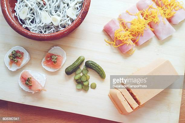 appetizers on chopping board - pate stock photos and pictures