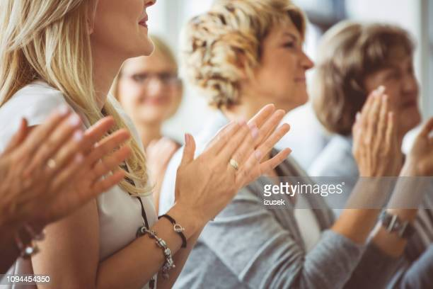 applauding at seminar - press conference stock pictures, royalty-free photos & images