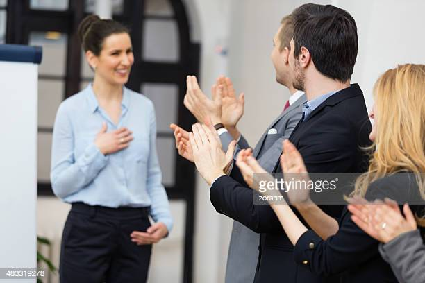 Applauding fsuccessful presentationor