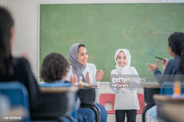 applauding presentation - islam stock pictures, royalty-free photos & images