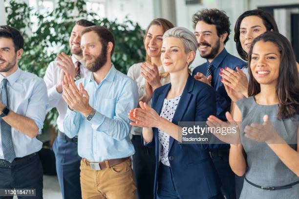 applause at business conference - medium group of people stock pictures, royalty-free photos & images