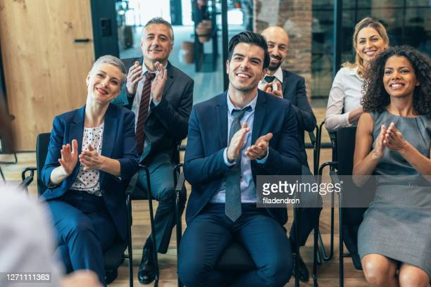 applause at business conference - global awards stock pictures, royalty-free photos & images