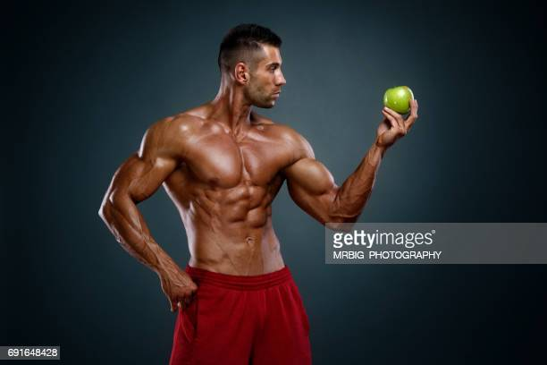 apple a day keeps doctor away - body building stock pictures, royalty-free photos & images