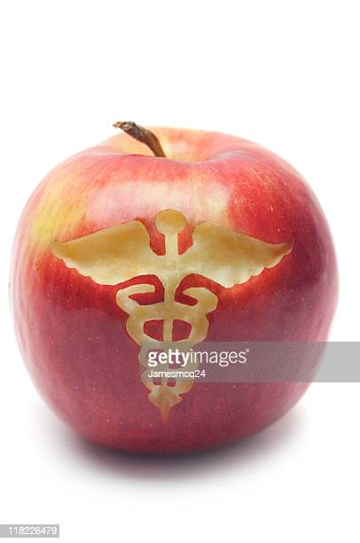 apple a day keeps the doctor away - medical symbol stock pictures, royalty-free photos & images