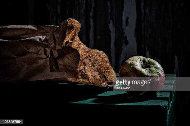 apple and bag - ian gwinn stock photos and pictures