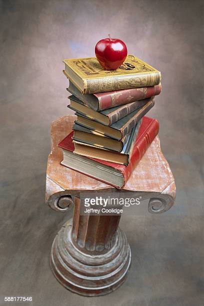 Apple and Books on a Pedestal
