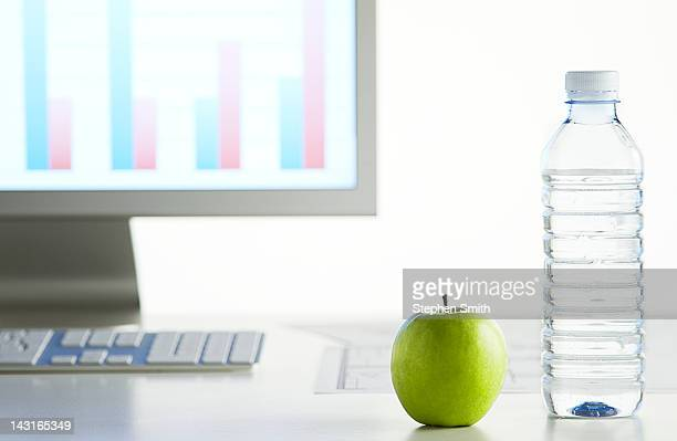 apple and bottle of water