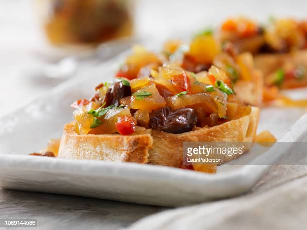 apple and ginger chutney with raisins on a crostini - chutney stock pictures, royalty-free photos & images