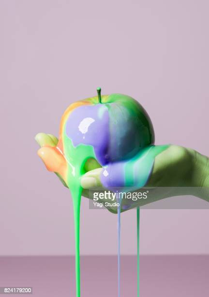 Apple and slime on color blocked background