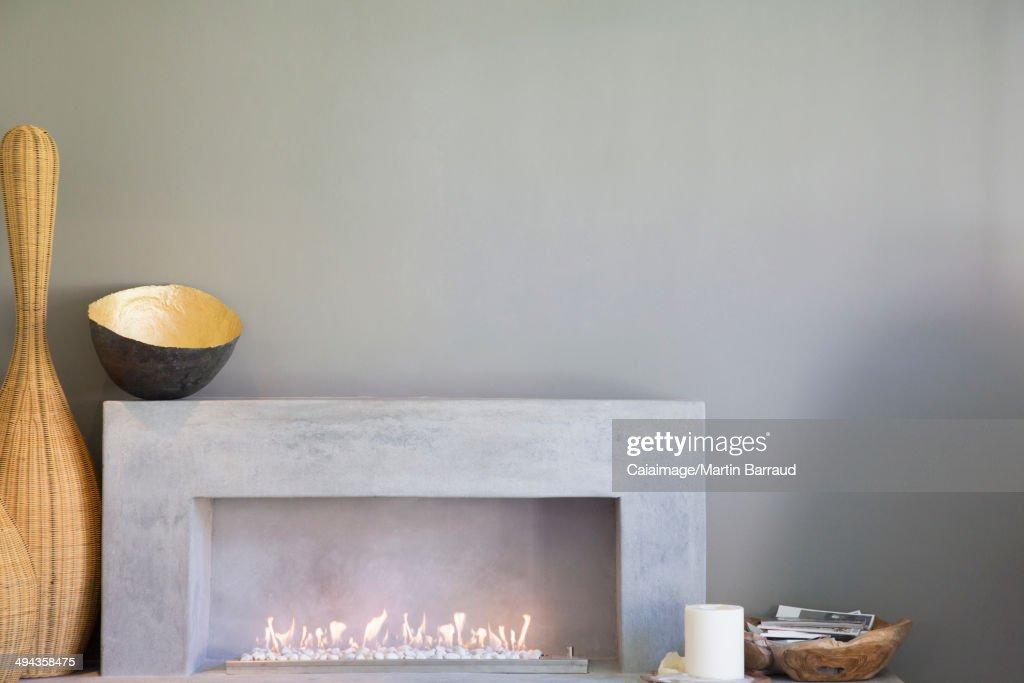 Apple art above fireplace in modern living room : Stock Photo