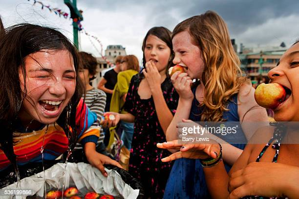 Apple bobbing on Southwark Bridge which is transformed into a giant banqueting space, designed by Cathy Wren, with visitors invited to share a meal,...