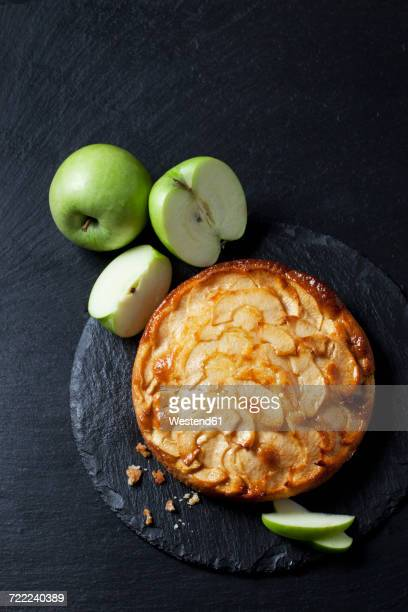 Apple cake and green apples on slate