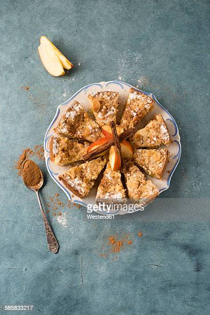 Apple cake with crumble and cinnamon on plate