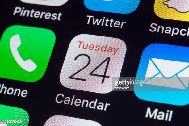 apple calendar, whatsapp, mail and other phone apps on iphone screen - tuesday stock photos and pictures