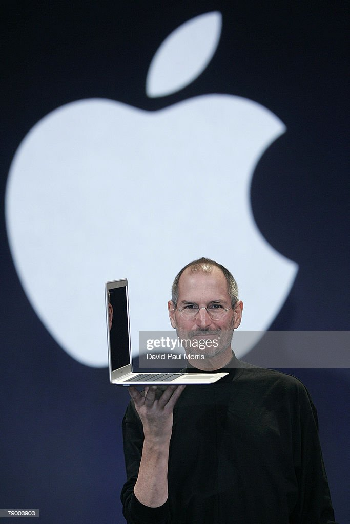 Apple CEO and co-founder Steve Jobs holds up the new Mac Book Air after he delivered the keynote speech to kick off the 2008 Macworld at the Moscone Center January 15, 2008 in San Francisco, California. Jobs introduced the wireless Time Capsule backup appliance, iTV 2 and the new ultra thin laptop MacBook Air.