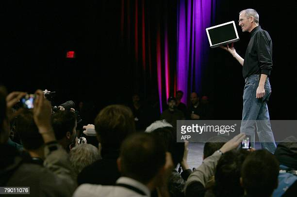 Apple CEO and cofounder Steve Jobs shows off the new MacBook Air ultra portable laptop to the media during his keynote speech at the MacWorld...
