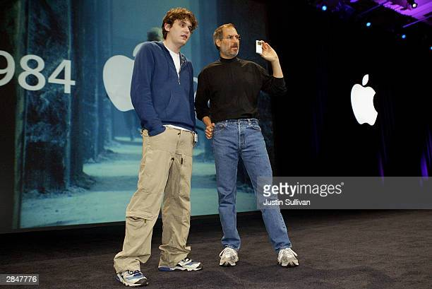 Apple CEO Steve Jobs and musician John Mayer show a new mini iPod at Macworld January 6 2004 in San Francisco Jobs announced several new products...