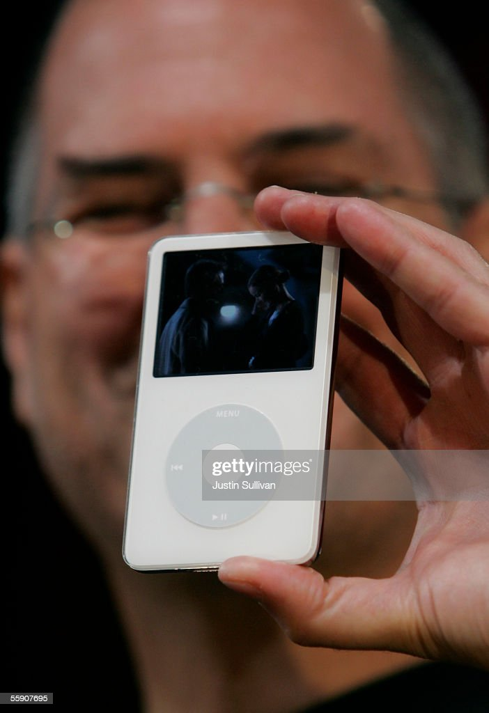 Apple CEO Steve Jobs holds a new iPod with video capabilities as he delivers a keynote address October 12, 2005 in San Jose, California. Apple CEO Steve Jobs announced a new iPod that plays video, a new iMac and new version of iTunes that allows people to purchase videos and television shows.