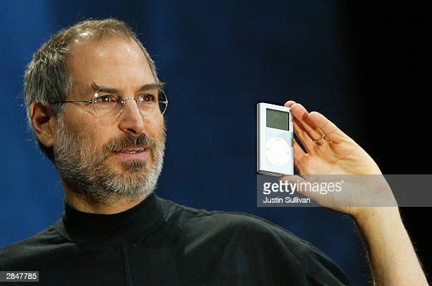 Apple CEO Steve Jobs holds a new mini iPod at Macworld January 6 2004 in San Francisco Jobs announced several new products including the new iLife 4...